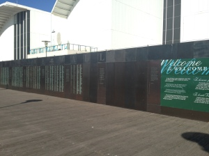 """The Welcome Wall, located at the Australian National Maritime Museum in Darling Harbour, stands in honour of all those who have migrated to live in Australia. Registered names are permanently engraved in bronze"""